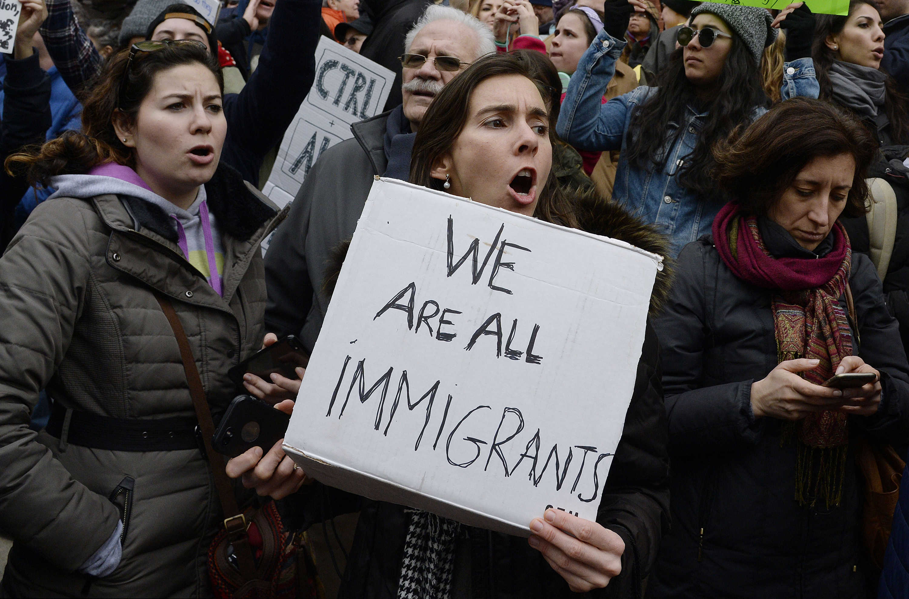 People gather at the White House to protest President Donald Trump's immigration plan on Sunday, Jan. 29, 2017 in Washington, D.C. (Olivier Douliery/Abaca Press/TNS)